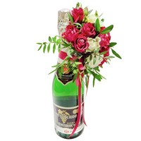 Bottle of champagne decorated with flowers