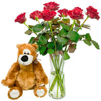 Bouquet of red roses with soft toy