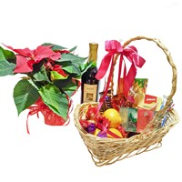 Gift basket with sweets, wine and poinsettia