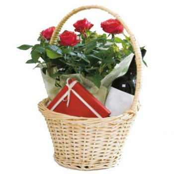 Basket with red roses, chocolates and wine