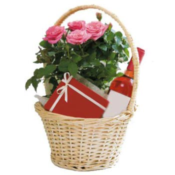 Pink roses, chocolates in basket - view more